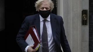 Britain's Prime Minister Boris Johnson leaves Downing Street to attend the weekly session of PMQs in Parliament in London, Wednesday, March 17, 2021.
