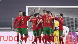 Portugal's players celebrate during their 2022 FIFA World Cup qualifying match against Azerbaijan.
