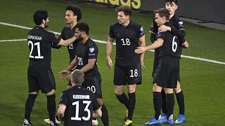 Germany's players celebrate during the 2022 FIFA World Cup qualifying match against Iceland.