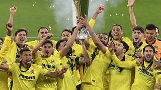 Villarreal players lift the trophy after the Europa League final soccer match between Manchester United and Villarreal in Gdansk, Poland, May 26, 2021.