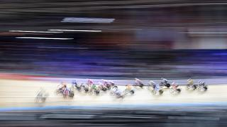 Athletes compete during the women's points races at the Cycling World Championship in Berlin, Germany, March 1, 2020.