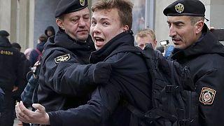 FILE - In this Sunday, March 26, 2017 file photo, Belarus police detain journalist Raman Pratasevich, center, in Minsk, Belarus.