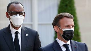 Before visiting Rwanda, French President Emmanuel Macron, right, welcomes Rwanda President Paul Kagame, with leaders of African states in Paris, Monday, May 17