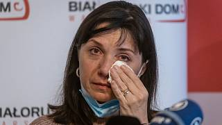 Mother of Roman Protasevich, Natalia Protasevich wipes tears from her eyes during a press conference in the Belarusian House Foundation in Warsaw