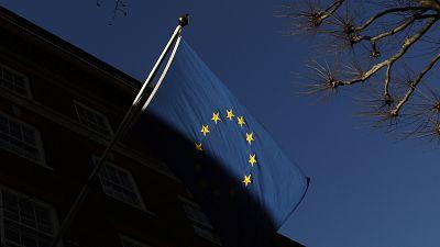 The European Union flag flies outside Europe House in London.