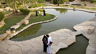 Visitors walk in a garden at the 18th century Diriyah fortified complex, that once served as the seat of power for the ruling Al Saud, in Riyadh, Saudi Arabia.