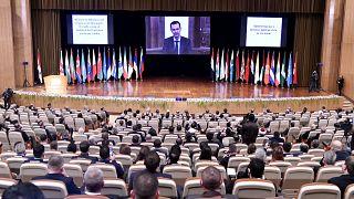 بشار الأسد يتحدث عبر الفيديو في مؤتمر اللاجئين السوريين الذي انعقد يومي الأربعاء والخميس (11 و12 نوفمبر/تشرين الثاني) في قصر الأمويين للمؤتمرات في دمشق