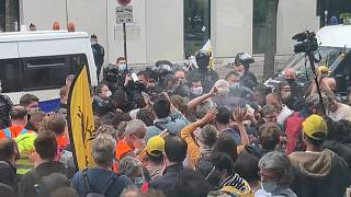 Protesters clash with police as they attempt to break up the protest