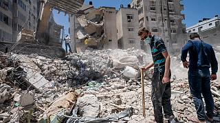 Heavy construction equipment is used to sift through rubble in Gaza City on Thursday, May 27, 2021.