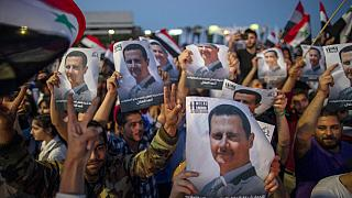 Crowds chanted: 'With our soul, blood, we defend you Bashar'