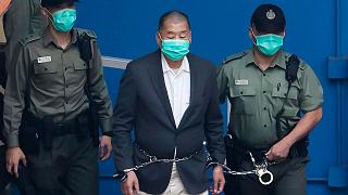 Jimmy Lai is escorted to get on a prison van, Hong Kong