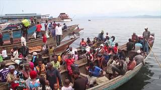 Residents escape Goma by boat amid eruption fears