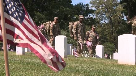 US soldiers place flags at Arlington National Cemetery ahead of Memorial Day