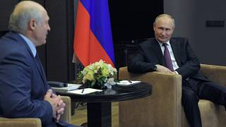 Russian President Vladimir Putin, right, listens to Belarusian President Alexander Lukashenko during a meeting in the Black Sea resort of Sochi, Russia, Friday, May 28, 2021.