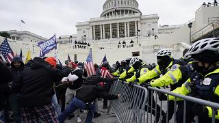 In this Jan. 6, 2021 file photo, violent rioters try to break through a police barrier at the Capitol in Washington.