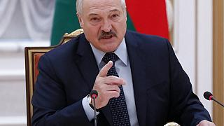 EU vows support for 'democratic' Belarus as Putin plays down diverted plane incident