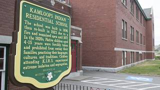 A plaque is seen outside of the former Kamloops Indian Residential School on Tk'emlups te Secwépemc First Nation in Kamloops, British Columbia, Canada on May 27, 2021.