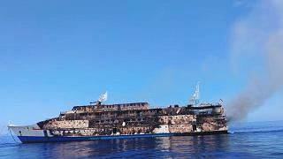 Smoke billows from the wreckage of KM Karya Indah ferry after it caught fire off Limafatola Island, Indonesia.