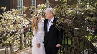Britain's Prime Minister Boris Johnson and Carrie Johnson pose together in the garden of 10 Downing Street after their wedding on May 29, 2021.