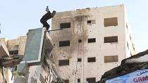 Palestinian youths practise parkour on rubble in Gaza