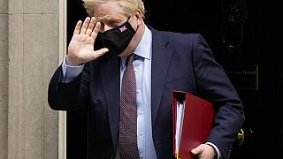 British Prime Minister Boris Johnson leaves 10 Downing Street to attend parliament in London on Wednesday
