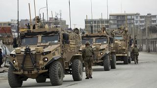 British soldiers with NATO-led Resolute Support Mission forces arrive at the site of an attack in Kabul, Afghanistan, March 25, 2020.