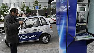 An electric car gets charged at the first Spanish telephone booth equipped to charge electric cars in Madrid