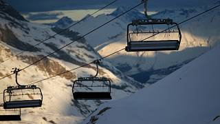 Chairlifts are stopped to stop the spread of the COVID-19 pandemic, in the ski resort of Val d'Isere, France, Dec. 18, 2020.