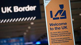 UK border signage is pictured at the passport control in Arrivals in Terminal 2 at Heathrow Airport in London
