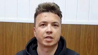 Roman Pratasevich speaks in a video from a detention center in Minsk, Belarus