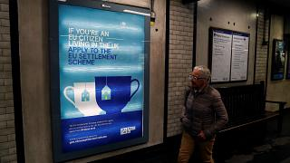 A poster encouraging EU nationals living in the UK to apply to the post-Brexit EU settlement scheme, at St James's Park underground station in London, March 25, 2019.