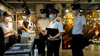 Police question staff at the June 4 Memorial Museum in Hong Kong