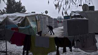 FILE: A Syrian refugee man clears the snow around his shelter at the refugee camp of Ritsona about 86 kilometres north of Athens, Wednesday, Jan. 11, 2017.