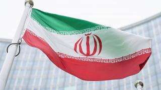 Iran's flag waves outside the International Atomic Energy Agency HQ in Vienna