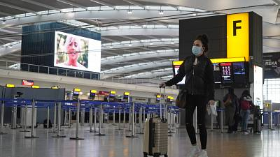 A passenger in the almost deserted departures hall at Terminal 5 of Heathrow Airport in west London on December 21, 2020.
