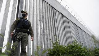 A police officer patrols alongside a steel wall at Evros river, near the village of Poros, at the Greek -Turkish border, Greece