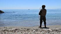 Moroccan migrants queue to seek asylum in Spain