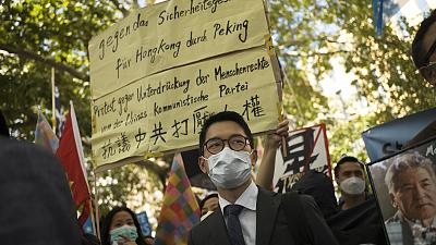 Hong Kong activist Nathan Law, centre, taking part in an anti-Beijing protest in Berlin, Germany.