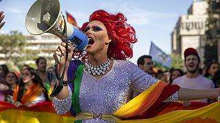 A participant dances in the annual Gay Pride parade in Jerusalem, Thursday, June 3, 2021.