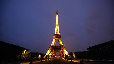 The Eiffel Tower is illuminated in Paris, Tuesday, May 25, 2021