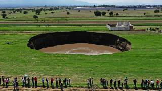 Aerial view of a sinkhole that was found by farmers in a field of crops in Santa Maria Zacatepec, state of Puebla, Mexico. May 30, 2021