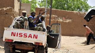 In this file photograph taken on June 27, 2012, Burkinabe soldiers patrol in a pick-up car in Gorom-Gorom, northern Burkina Faso.
