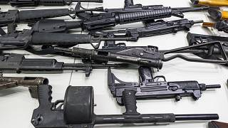 In this Dec. 27, 2012, file photo are some of the weapons that include handguns, rifles, shotguns and assault weapons, collected in a Los Angeles Gun Buyback event.