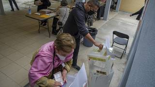 People cast their vote at a polling station, in Mexico City, on June 6, 2021