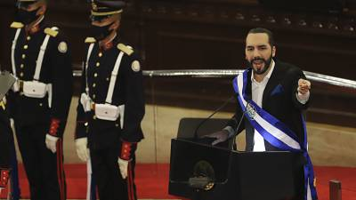 El Salvador's President Nayib Bukele delivers his annual address to the nation before Congress, in San Salvador, El Salvador, Tuesday, June 1, 2021.