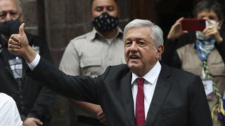 Mexico's President Andres Manuel Lopez Obrador thumbs up after voting in congressional, state and local elections in Mexico City, June 6, 2021.