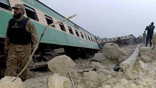 Army, police and rescue workers gather at the site of a derailed train in near Rohri, in southern Pakistan, Sunday, March 7, 2021.