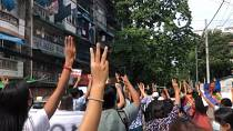 Dozens march briskly through Yangon in flash Myanmar protest
