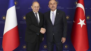 French Foreign Minister Jean-Yves Le Drian, left, and Turkey's Foreign Minister Mevlut Cavusoglu