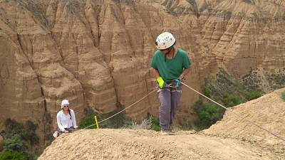 Charlotte Prud'homme (pictured left) abseiling to collect soil samples.